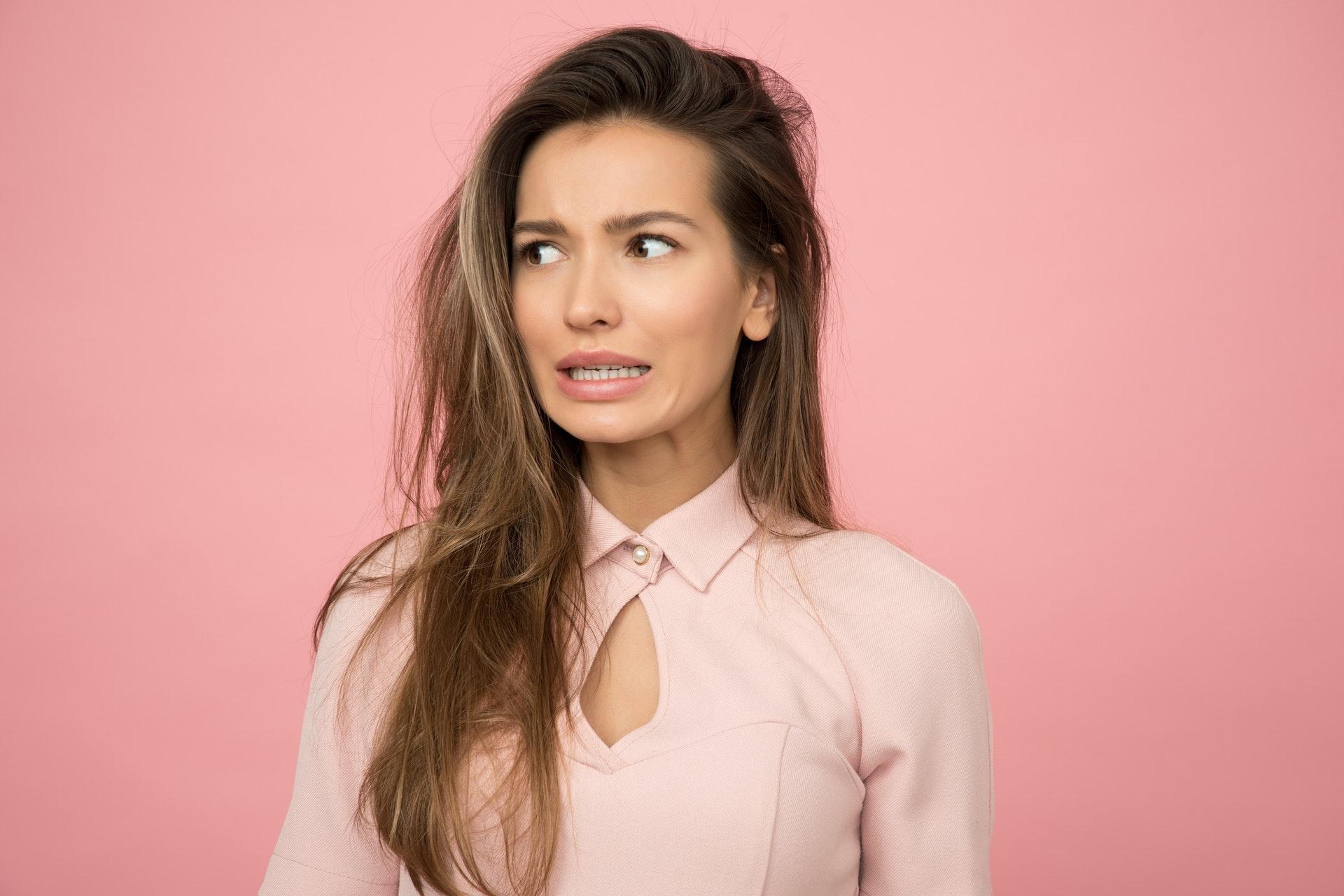 woman-wearing-pink-top-1036620